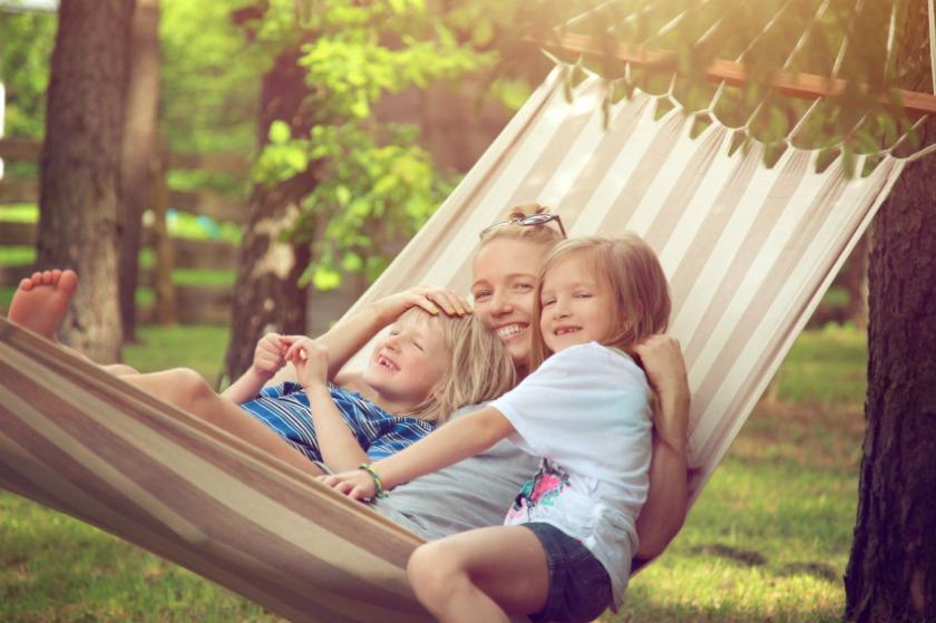 Family sitting in hammock