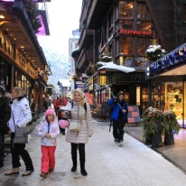 Shoppers and après skiers enjoy some high street browsing.