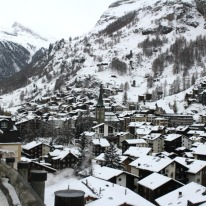 Zermatt village from an elevated walking trail. The Matterhorn is hidden by mist.