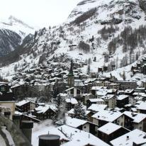 Zermatt village from an elevated walking trail. The Matterhorn is hidden by mist.