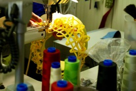 A lemon-colored hat under construction at Zabo.