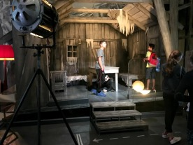 Teenagers explore the Little Tramp's cabin in The Gold Rush.