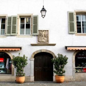 For the most part, shopfronts fit in comfortably with their older surroundings.