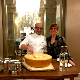 Cozying up to Head Chef Alessio Corda as he prepares his signature dish, Risotto Mantecato, prepared in a wheel of Parmigiano-Reggiano.